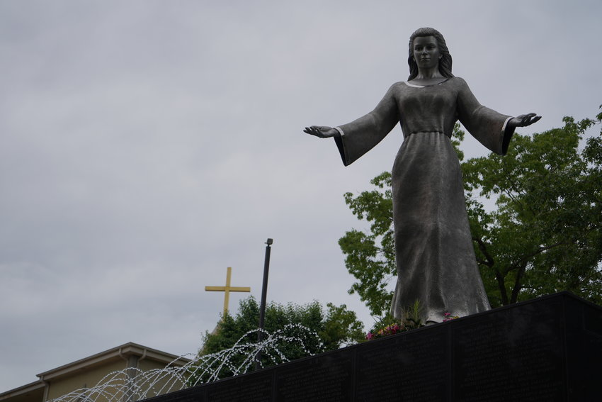 The sculpture of Mary, Mother of the Church, is a prominent element of the national shrine.