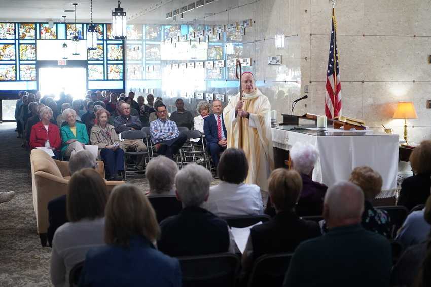 Bishop McKnight preaches the homily at Mass in the cemetery mausoleum, focusing on the Resurrection and the Communion of Saints.