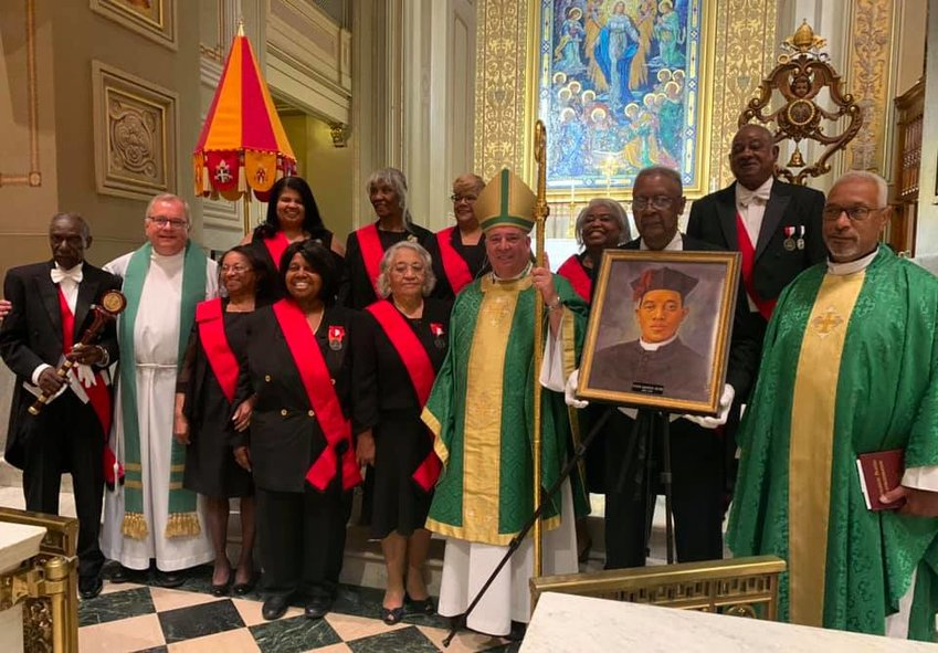 Archbishop Nelson Perez of Philadelphia gathers with members of his archdiocese's chapter of the Tolton Ambassadors, a group dedicated to promoting Venerable Father Augustus Tolton's sainthood cause, after a June 26 Mass in Fr. Tolton's honor in the Cathedral Basilica of Ss. Peter and Paul in Philadelphia.