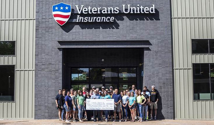 Representatives of the Veterans United Foundation and present a $50,000 check to Catholic Charities of Central and Northern Missouri toward the renovation of the former La Salette Seminary building in Jefferson City into a state-of-the-art hub of ministry and charity, set to open later this year.