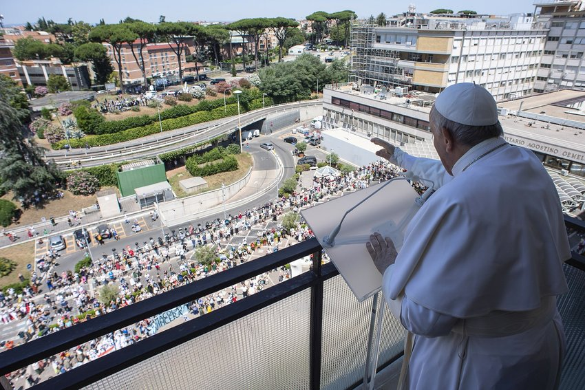 Pope Francis greets the crowd as he leads the Angelus from a balcony of Gemelli hospital in Rome July 11, 2021, as he recovers following scheduled colon surgery.