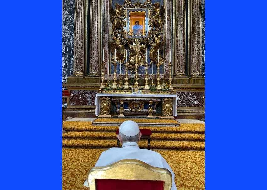"""Pope Francis prays in front of the Marian icon """"Salus Populi Romani"""" at the Basilica of St. Mary Major in Rome July 14, 2021. The pope visited the basilica after his release from Rome's Gemelli hospital following his recovery from colon surgery."""