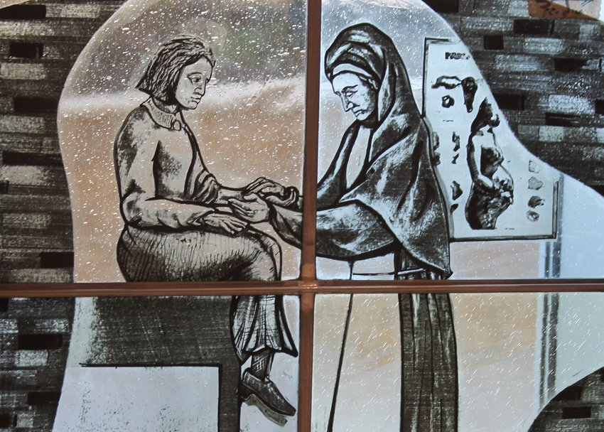 An image in an art glass window in the hospital chapel represents one of the many sisters who founded the hospital and treated patients there for many decades.