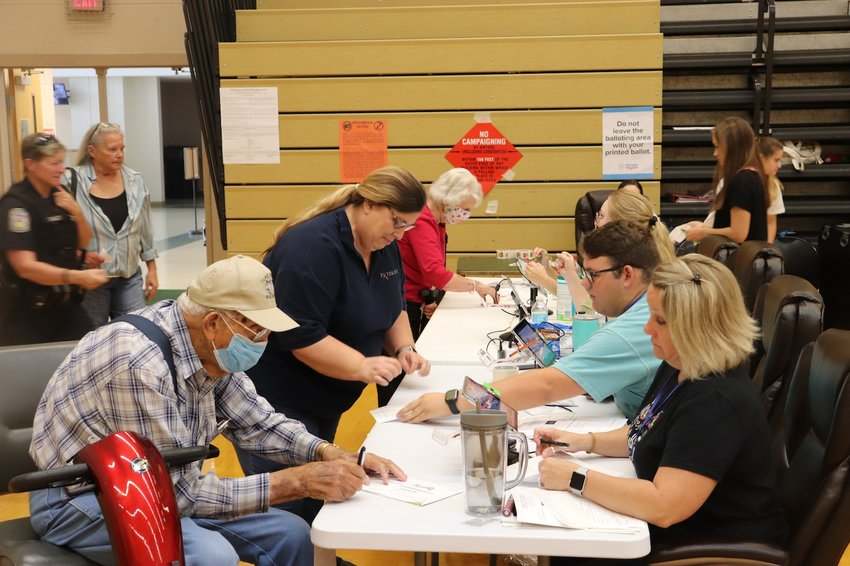 Election workers help voters prepare to cast their ballots at the Murray County Recreation Center on Tuesday. Local, state and federal races were included on the ballot. Voting went smoothly, according to Murray County Election Supervisor Larry Sampson.