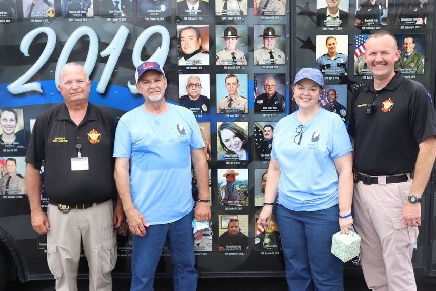 From left, Sheriff Gary Langford, Michael Smith, Annette Smith and Chief Deputy Jimmy Davenport are pictured in front of the End of Watch: Ride to Remember mobile exhibit which visited Chatsworth in honor of Deputy Jailer Michaela Elizabeth Smith, who died in 2019. Michaela's picture is in the center, between her parents.