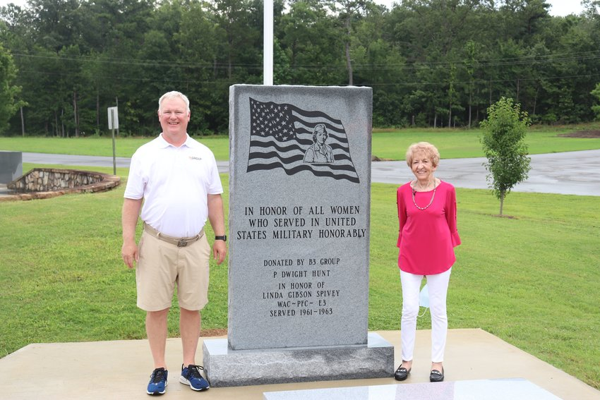 Lt. Col. Dwight Hunt and Linda Spivey pose with the new monument to women veterans of war that was unveiled at the Veterans Memorial Park in Chatsworth on Saturday.