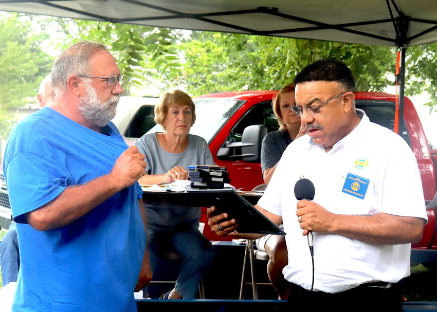 Left, Chuck Smith, president of the Spring Place Ruritan Club, listens as Ruritan National President Linward Hedgspeth recognizes the local club for its 70th year of service to the community. Hedgspeth, of Rougemont, N.C., attended the Spring Place Community Festival on Saturday.