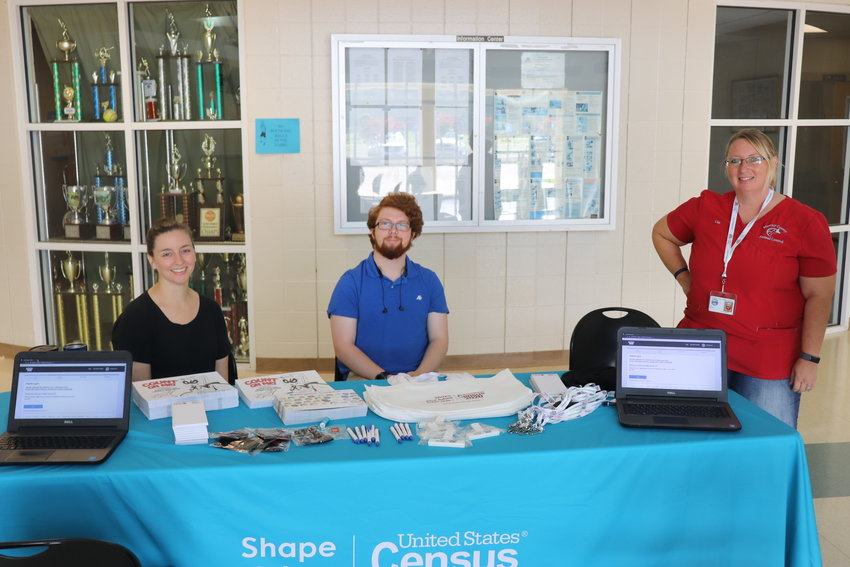 From left, Kelsey Dotson, Ethan Bridges and Lisa Gowens, all of Murray County, volunteered to help promote the U.S. Census at the Murray County Recreation Center on Election Day.