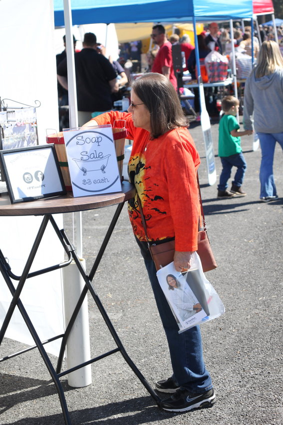 Becky Herron of Chatsworth examines an item for sale at Black Bear.