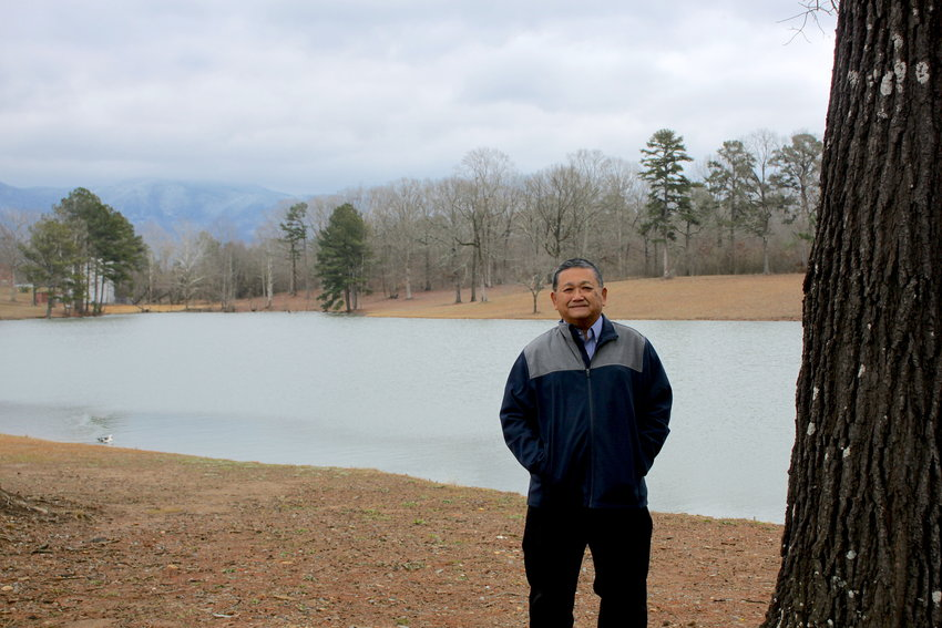 Chatsworth Mayor K.W. Gong on Monday braves chilly winds while standing on the property off Industrial Boulevard where the city expects to build a park, including a walking trail, picnic tables and swings.