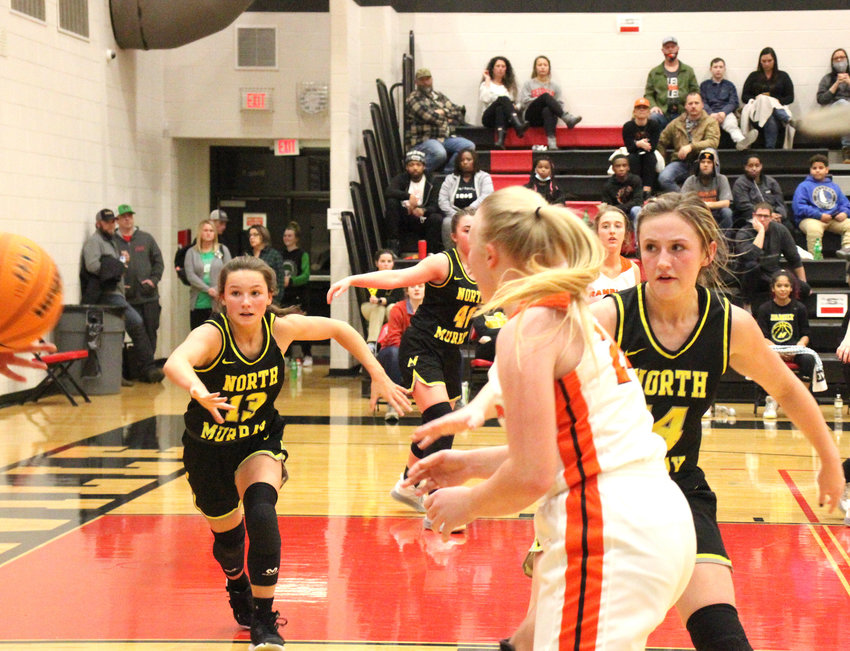 North Murray's Lauren Davis (13) and Abby Young (14) pressure the inbounds pass against LaFayette on Monday in region tournament play at Sonoraville.