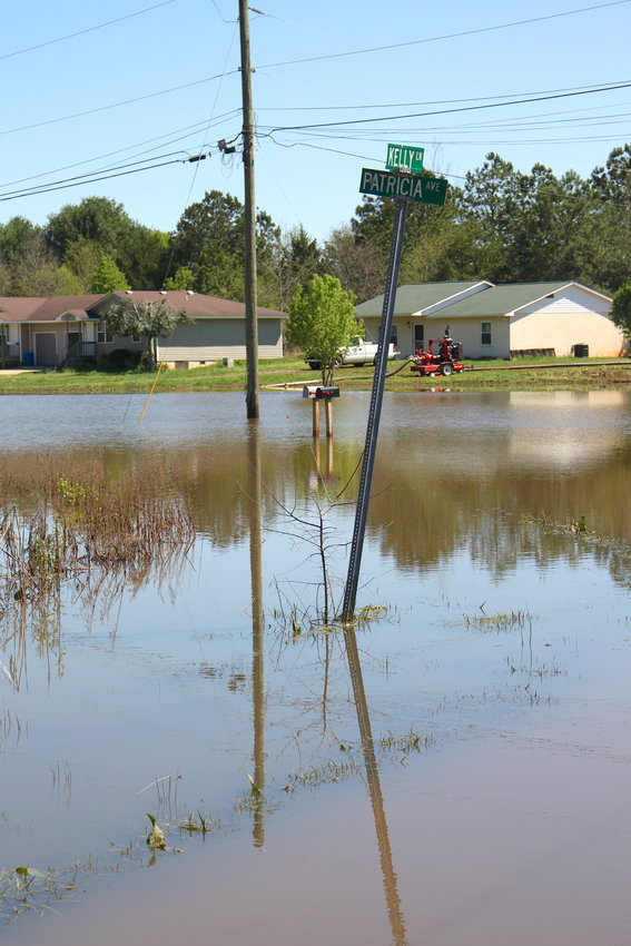 A county-owned water pump labors away on Monday afternoon, pulling water away from the Patricia Avenue-Kelly Lane neighborhood hit hard by flooding.