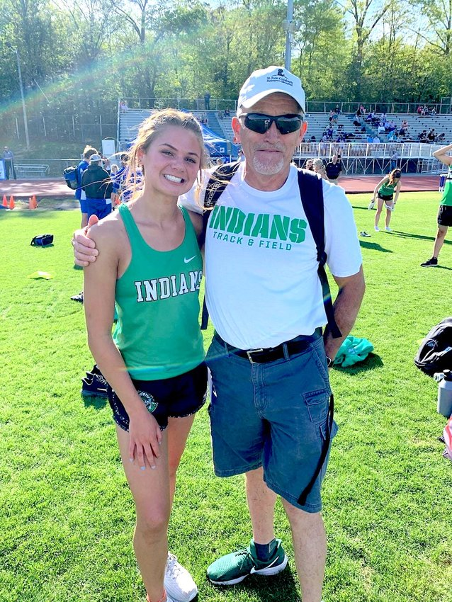 Laine McConkey with jumping coach Sam Young.