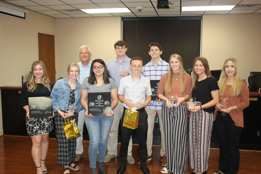 Family Connections presented its Community Champions award to student nominees from all three Murray County high schools on Monday at the monthly meeting of the Murray County Board of Education. Pictured (from left) are Madeline Skojac, Rylee Brock, Superintendent Steve Loughridge, Anastasia Priest, Lincoln Puryear, Ethan Jackson, Landon Hansird, Savannah Parrish, Aubrianna Green and Rebecca Moffett. The students were recognized for their volunteer activities which benefited the local community.