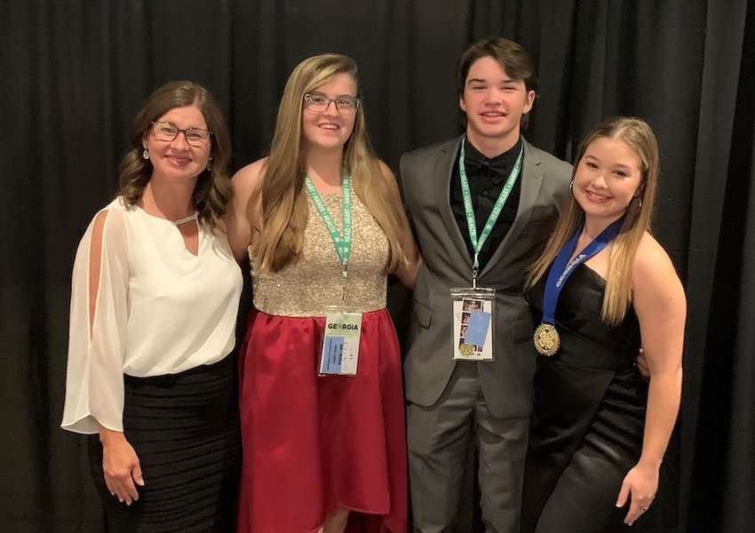 At 2021 State Congress, (from left) Stephanie Skojac (4-H Extension agent), Kylee Johnson, Daniel Skojac and Madeline Skojac.