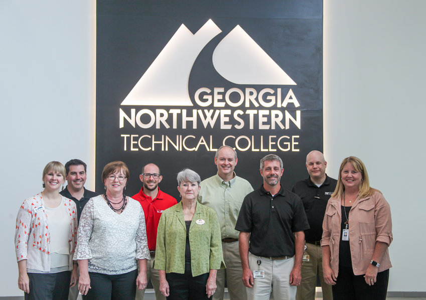 (Front from left) Deanna Mathis, Shaw director of Corporate Outreach; Emily Lightsey, Shaw plant manager; Linda Case, GNTC Board of Trustees Vice Chair; Chad Anderson, Shaw director of Collaborative Innovative Manufacturing (CIM); and GNTC President Dr. Heidi Popham (back row) Darrell Huggins, GNTC program director and instructor of Automation Engineering Technology; Colin Drafts, Shaw plant manager; Winston Massengale, Shaw vice president of Automation and Engineering; and Brian Cooksey, Shaw director of Workforce Development.