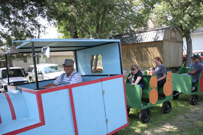 Engineer (and county tax commissioner) Billy Childers delivers passengers safely to their destination during the  Model Train Expo at the Chatsworth Depot on Saturday. Visitors toured the historic depot and caboose and saw an array of operational model trains.