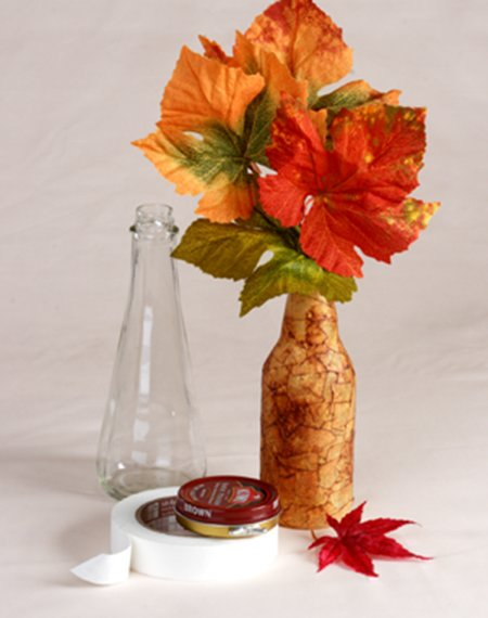 Colorful leaves in faux leather vase