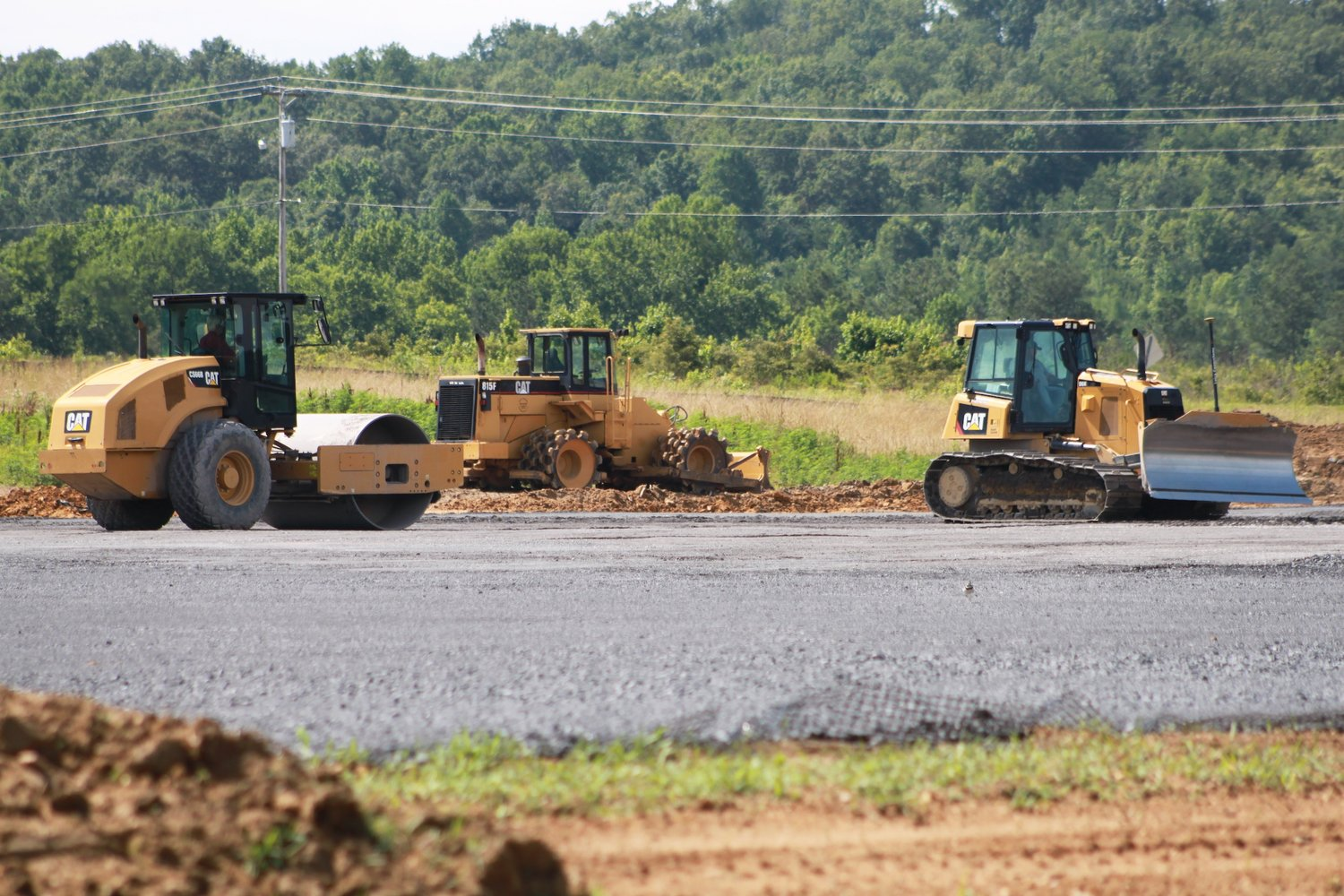 Paving work continues at Crandall site of new transportation company.