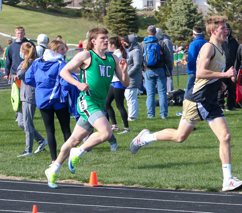 Thomas Lokken of Wilber-Clatonia keeps pace with Trey Fischer of Thayer Central in the 1,600-meter run March 30. Lokken was second and Fischer third in the race.