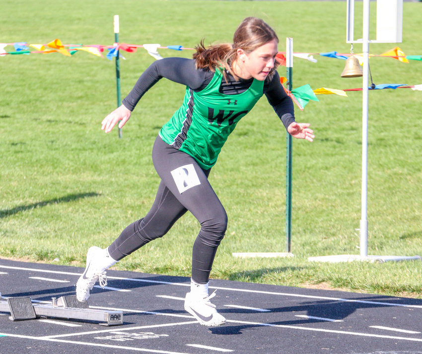 Tatiana Meza leaves the blocks in the 400-meter dash March 30 in the Wilber-Clatonia Invitational.