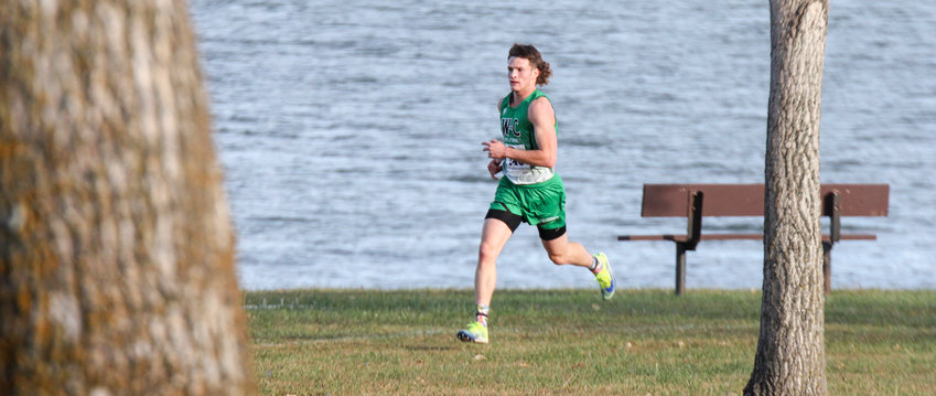 Tommy Lokken of Wilber-Clatonia leads the way around the Branched Oak Lake course during district cross country Oct. 15.