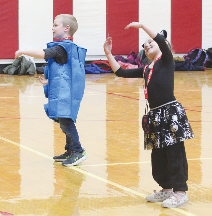 Sloane MIlton (left) and Ember Cook (right) perform moves to a Halloween dance Oct. 30.