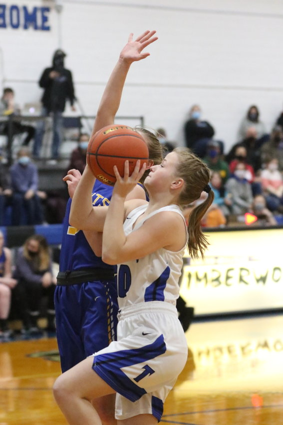Jozie Kanode gets the steal and the fast break for the Timberwolves against Nebraska Lutheran.