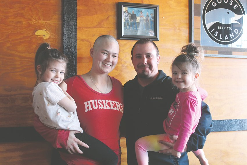 City Slicker's Bar and Grill in Dorchester on March 31 held a benefit to raise money for Saline County Sheriff's Deputy Jen Warning, who was diagnosed with breast cancer in December. Pictured are, from left, Devanie Warning, four years old, Jen Warning, Casey Warning and Lainey Warning, three years old.