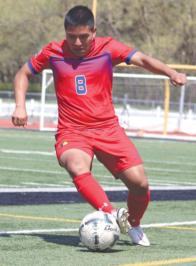 Hugo Lopez uses his footwork to keep the ball in bounds and in play during the Cardinals.