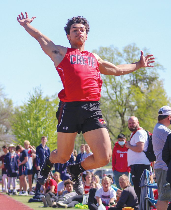 Isaac Kracl of Crete looks for the sand in the long jump April 29 at the Crete Invitational.