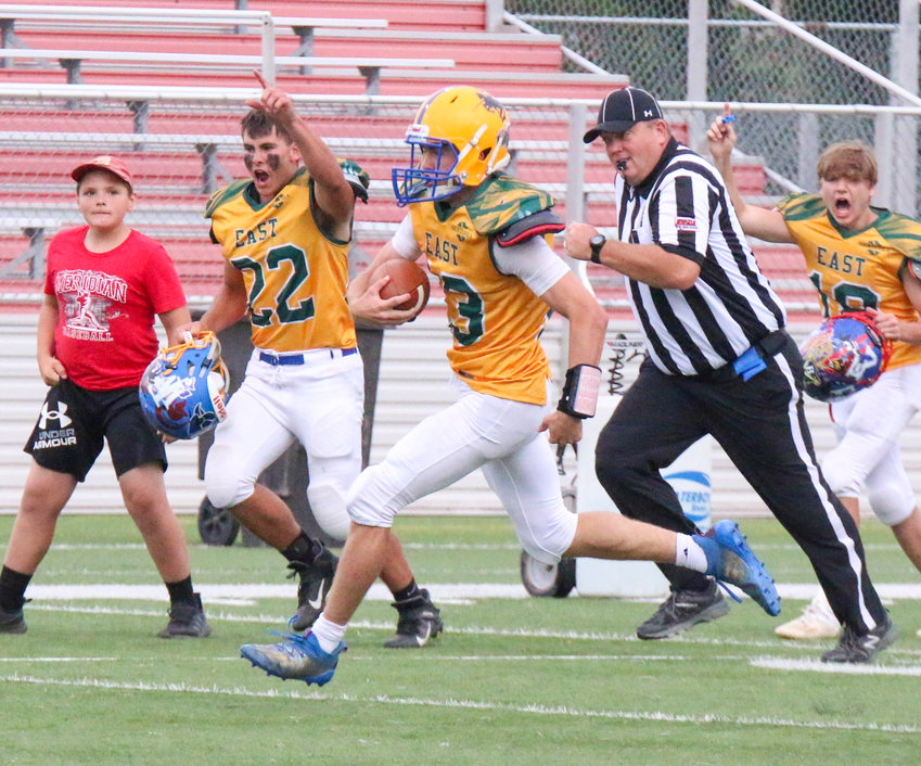 Cole Siems (13), a graduate of Tri County High, races toward the endzone as teammate Anthony Isom of Allen (22) keeps pace June 19. The East beat the West in the Sertoma 8-Man All Star Game 40-29. Siems played quarterback for the East and finished with 170 yards on 19 carries and scored twice and completed four of five passes for 96 yards and two touchdowns. Siems was named the offensive player of the game for the East.