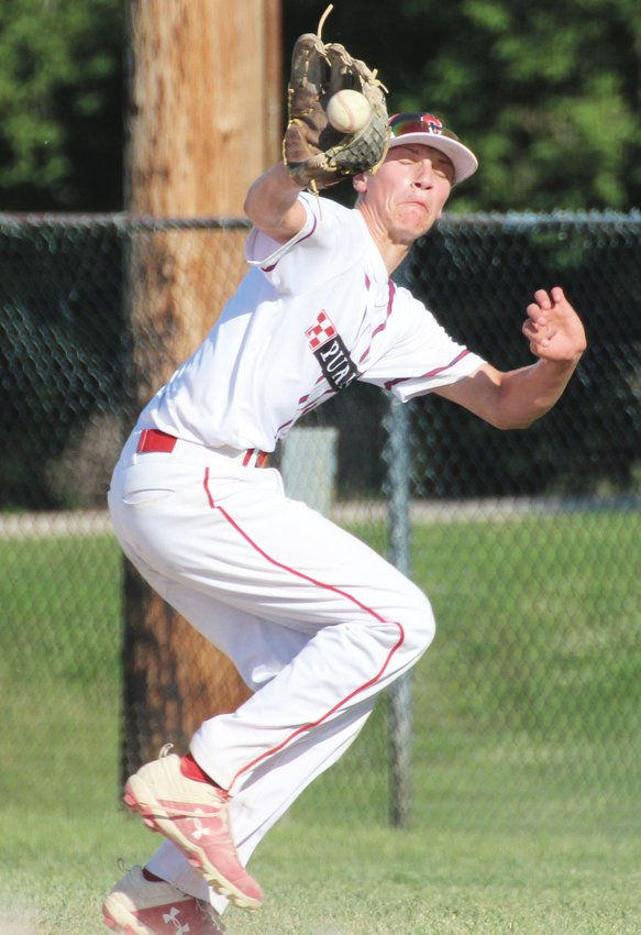 Crete Post 147 Nestle Purina juniors' first baseman Connor Krumme snares the ball during a game on June 16.