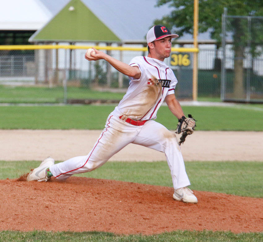 Brett Ladely delivers a pitch for the Crete Nestle Purina juniors during their 12-0 win over Seward June 26.