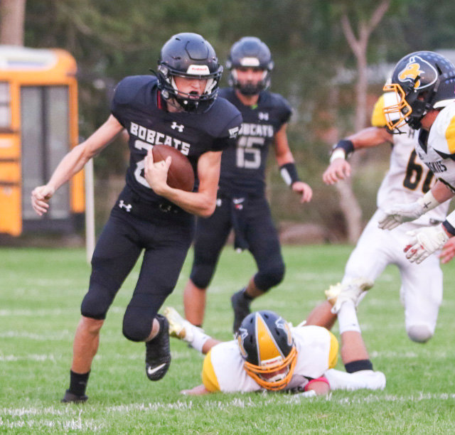 EMF's Jesse Duba carries the ball for a few yards for the Bobcats during Sept. 10's Exeter-Milligan homecoming game.