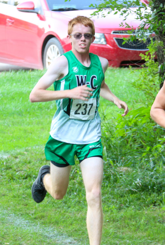Logan Herndon of Wilber-Clatonia strides down the Doane University course during the Milford Invitational Sept. 9.