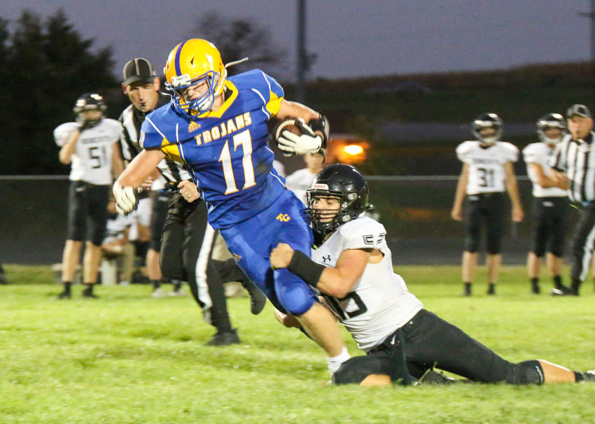 Christopher Janssen of Tri County fights for more yards as EMF's Christian Weber tries to make the tackle Sept. 17.