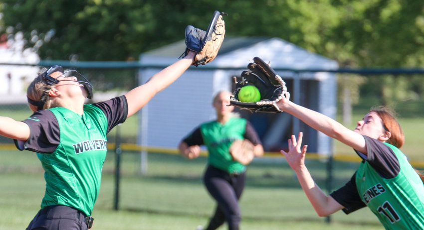 Delaney Mazza, left, and Kaycee Rezabek stretch to make a catch in the outfield for Wilber-Clatonia Sept. 18.