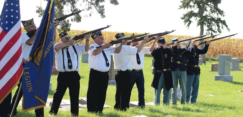 """Members of the Dorchester American Legion Post 264 and the Nebraska and Dakota Sons of the Union Veterans of the Civil War conduct a gun salute at the last soldier buried ceremony for Jeremiah """"Jerry"""" Wilhelm at the Dorchester Cemetery Sept. 18."""
