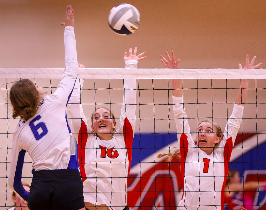 Crete's Sierra Bond, left, and Maggie Wohl put up a block against Columbus Lakeview's Maddi Vogt.