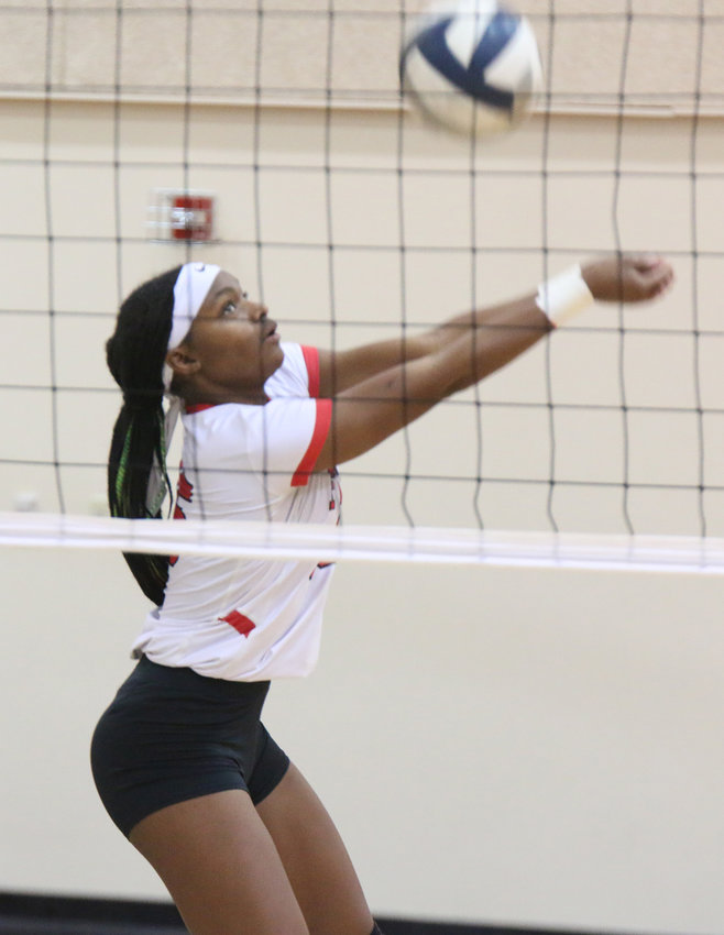 Kiarra Fennell of Friend passes the ball back over the net against Heartland Oct. 9.
