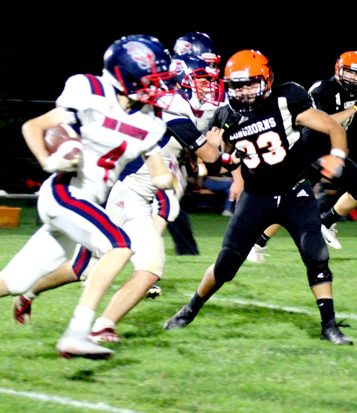 Senior Jose Tellez zeroes in on a Red Hornet ball carrier during Dorchester's homecoming game Oct. 8.