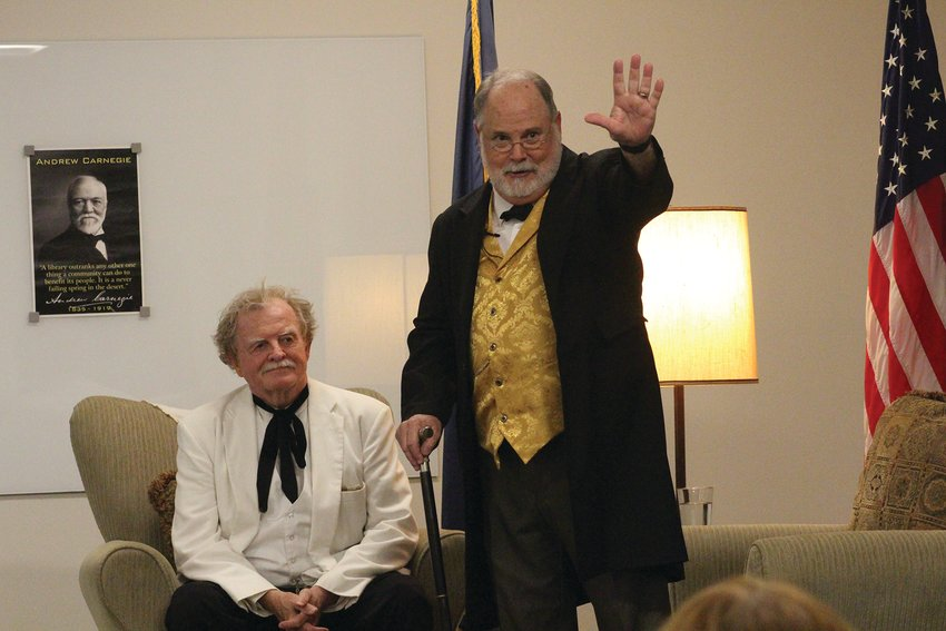 Mark Twain (Warren Brown) and Andrew Carnegie (Tom King) poke fun at each other while talking about their backgrounds during the Crete Public Library fundraiser.