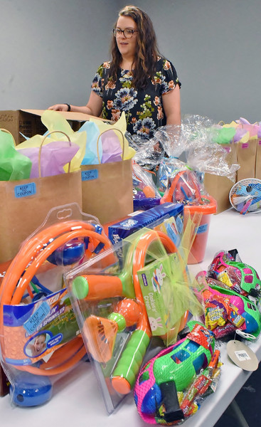 Katie Gobbi, director of the Euharlee Welcome Center & History Museum, looks over some of the prizes to be given away at Saturday's Easter Egg Hunt at Joe Cowan Park.