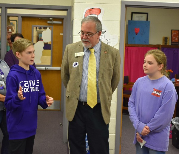 Cartersville Elementary fifth-graders Will Feuerbach and Jocelyn Wright talk with state school Superintendent Richard Woods during his visit to the school March 23.