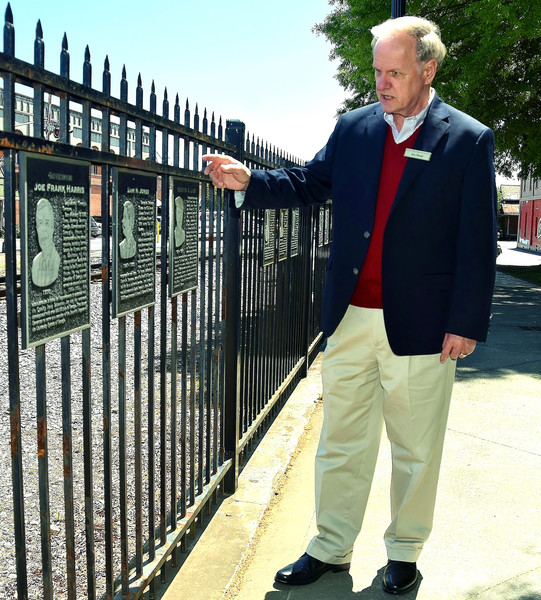 Etowah Valley Historical Society Vice President Joe Head reviews some of the plaques in downtown Cartersville's Friendship Plaza that pay recognition to significant individuals in Bartow County history.