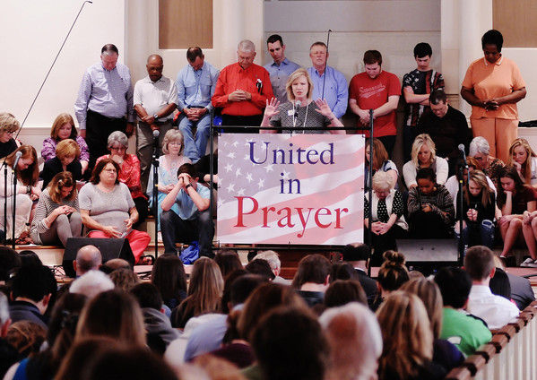 Bartow Family Resources Executive Director Maryland Guthas leads worshippers in prayer during last year's National Day of Prayer rally, which was held at the former Cartersville First Baptist Church due to rain.
