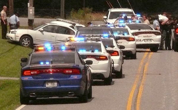 Ten patrol cars from the Georgia State Patrol and Bartow County Sheriff's Office chased a Tennessee man with a drug warrant. The chase began on Rudy York Road and ended on Cass White Road near Shinall Gaines Road.