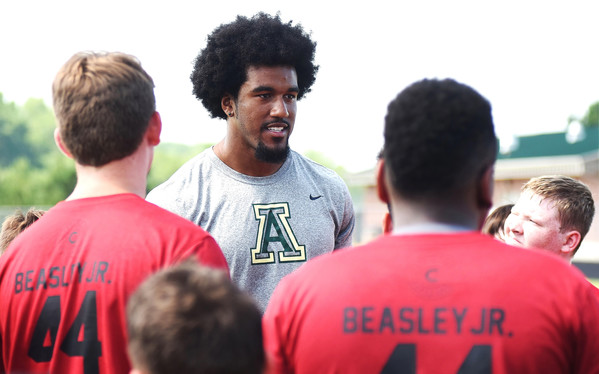 Adairsville High alumnus and current Atlanta Falcon Vic Beasley Jr. speaks with some of the more than 200 youngsters who attended his football camp Saturday at the high school.
