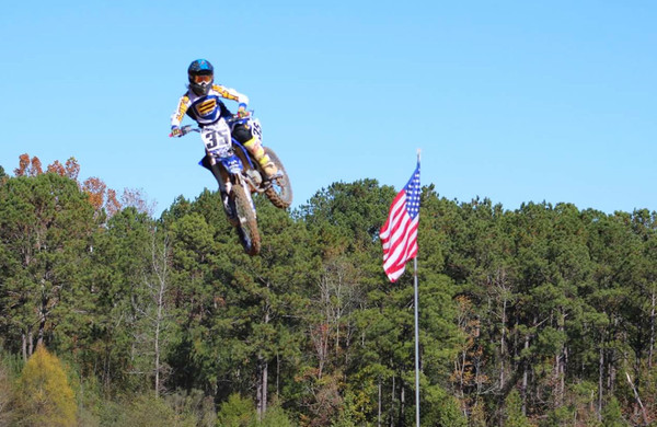Cartersville High rising junior Ezra Parker soars on his dirt bike.